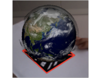 Deomnstration of Fraunhofer's Augmented Reality system showing a virtual Earth globe on a marker. The system tracks the movement of the marker.
